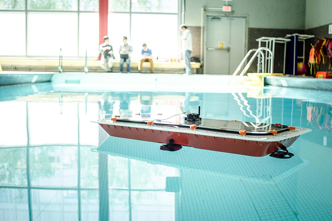 A prototype autonomous RoBoat hits the water in a swimming pool test run