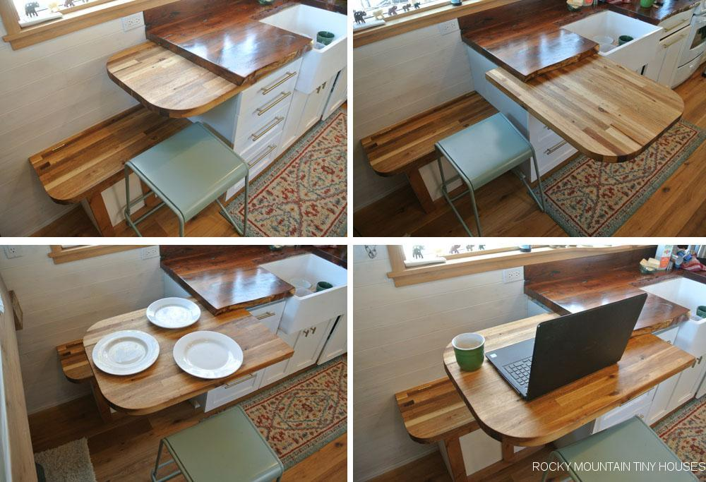 The San Juan Tiny House features  a small dining table/desk area