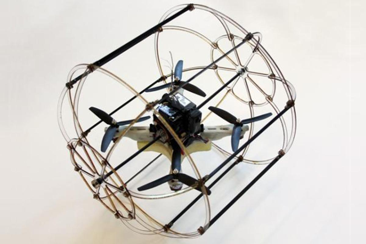 The cylindrical cage of the HyTAQ (Hybrid Terrestrial and Aerial Quadrotor) gives the robot both aerial and rolling terrestrial locomotion capabilities (Photo: