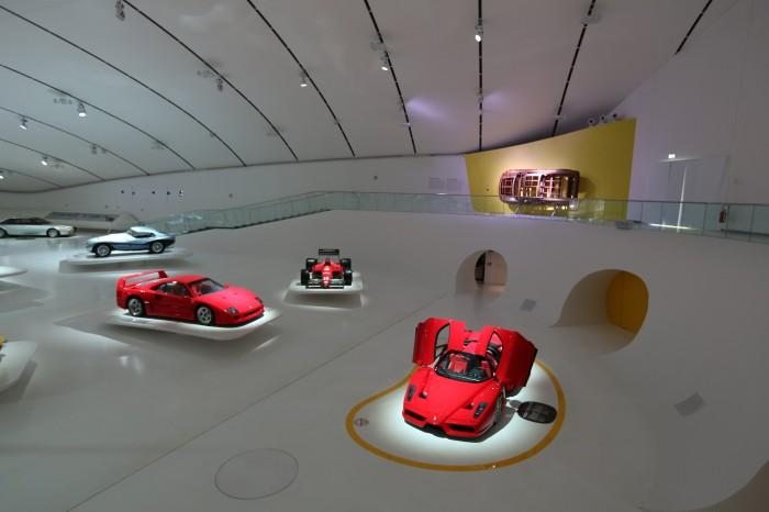 Inside the gallery, classic Ferrari's like the Testarossa, Dino, 410S and 166 MM Barchetta float effortlessly on specially designed platforms while newer models like the Enzo and F40 sit nearby (Photo: Museo Casa Enzo Ferrari)