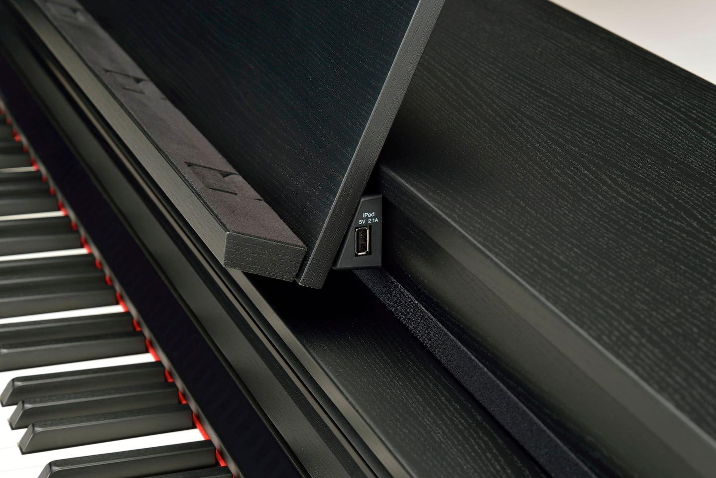 The iPad running the Smart Pianist app is cabled to the Clavinova CSP piano using a port hidden behind the music stand