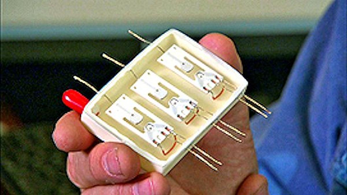 Three Sandia neutrister neutron generators mounted in a test box under vacuum