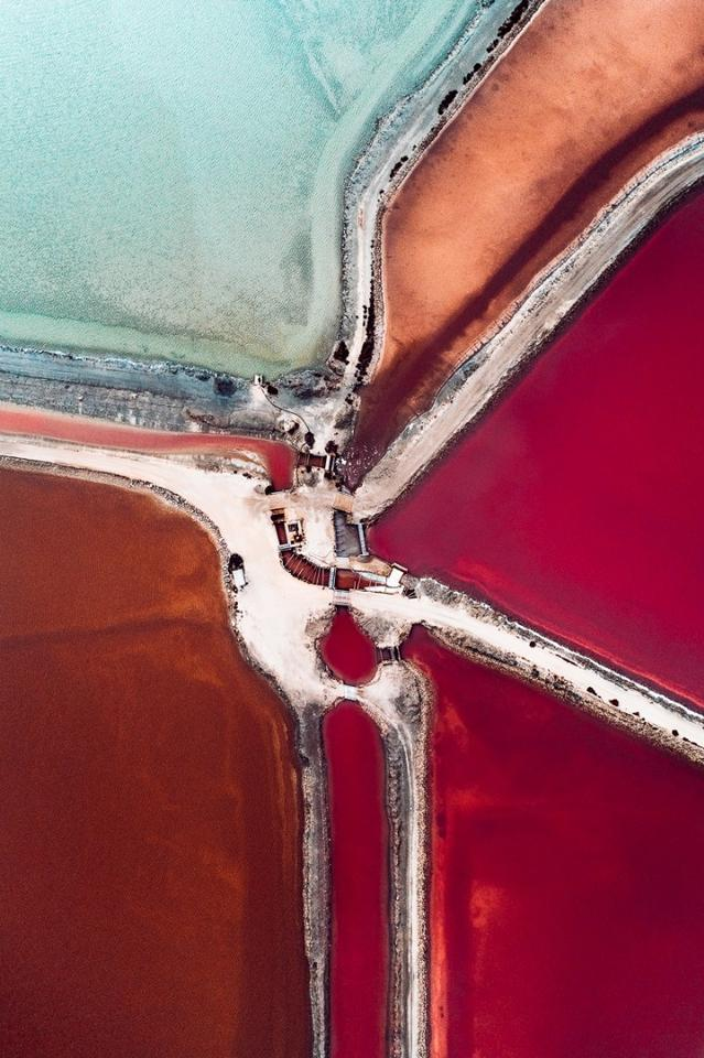 The Salt Series: Chronicling the harvesting of sea salt using artificially created ponds. The color of the water indicates the salinity of the ponds with micro-organisms changing their hues as the salinity of the pond increases