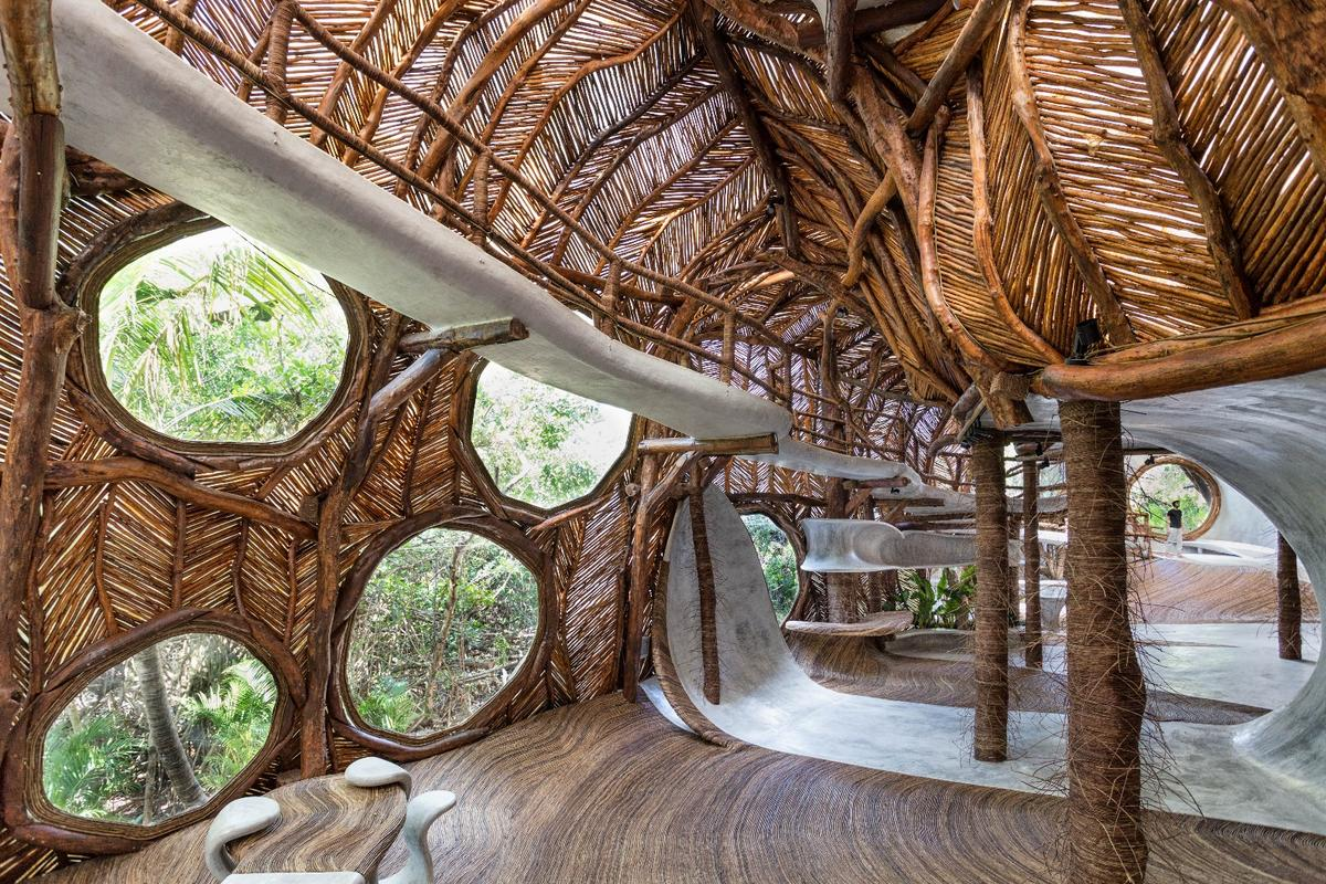 Large circular windows let loads of light into the IK Lab in Tulum, Mexico