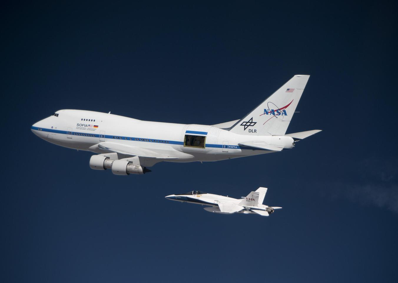 SOFIA, with her cavity doors open and a NASA F/A-18 in tow (Photo: NASA/Jim Ross)