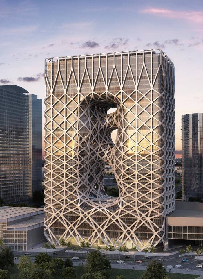 The oddly-skinned structure by Zaha Hadid Architects, with its white elastic wrapping element, features a similar exterior narrative to the Beijing Olympics National Stadium (Bird's Nest)