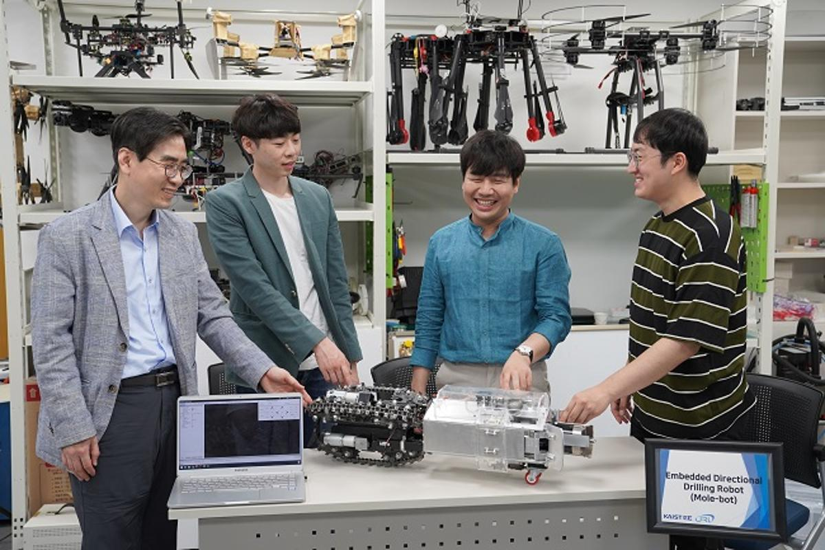 From left: Prof. Hyun Myung, PhD candidate Junseok Lee, researcher Christian Tirtawardhana and PhD candiate Hyunjun Lim, with the Mole-bot