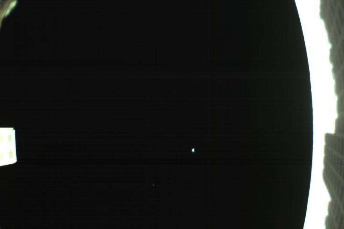 The first image returned by one of NASA's Mars Cube One (MarCO) CubeSats shows the Earth and Moon