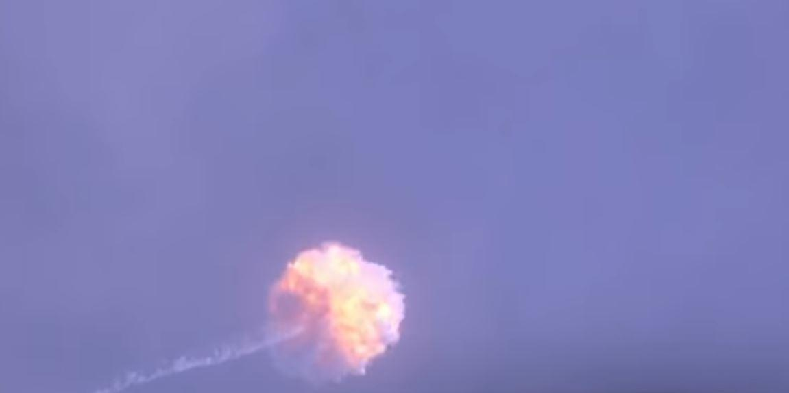 The Falcon 9 rocket breaking up during the abort test