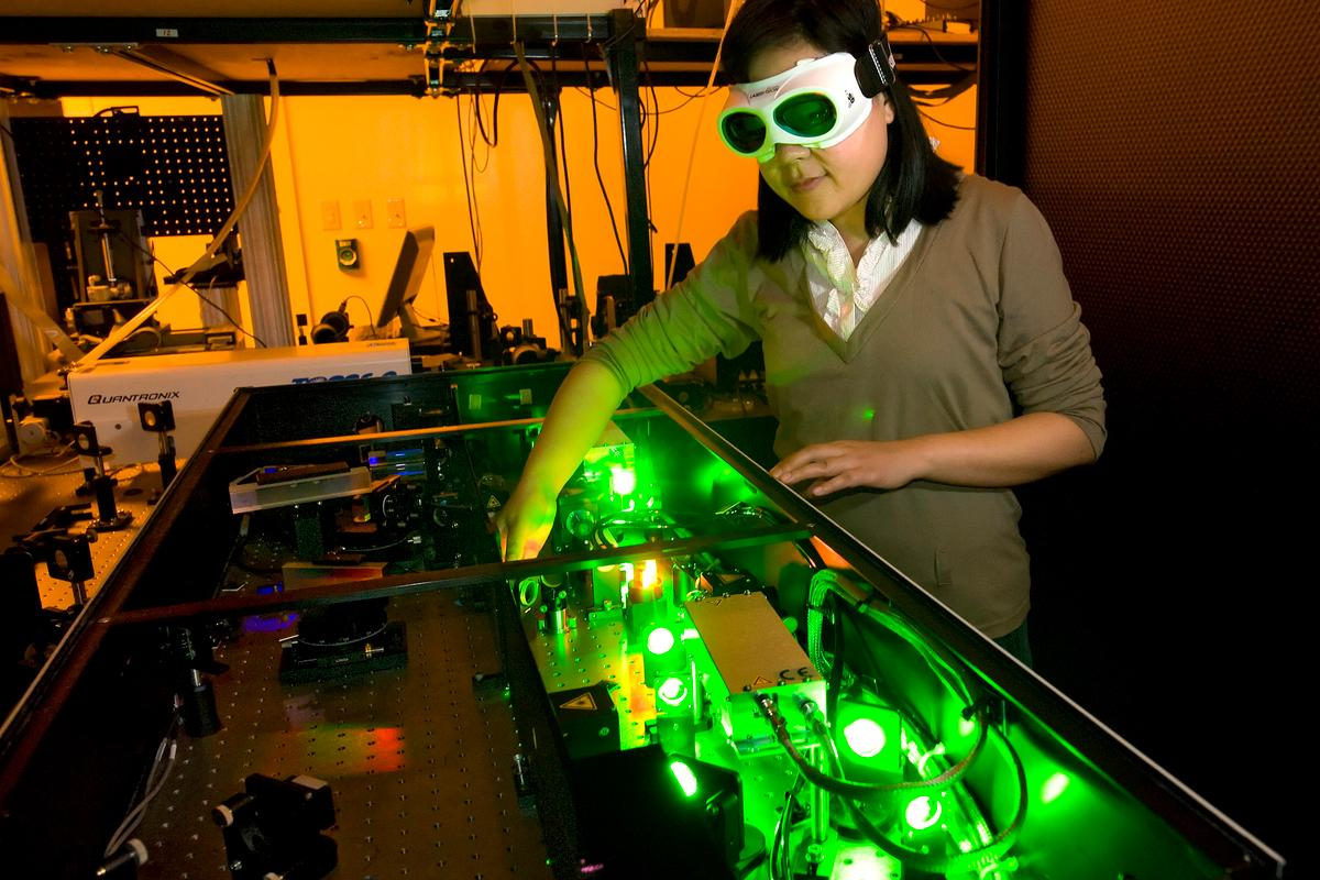 Purdue mechanical engineering student Yaguo Wang works with a high-speed laser at the Birck Nanotechnology Center to study thermoelectric generators (Photo: Purdue/Mark Simons)