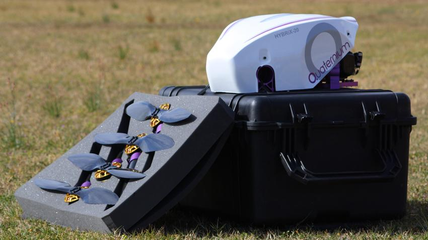 The HYBRiX.20 fuel-electric quadcopter with its box