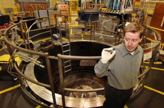 Sandia researcher Marcus Knudson considers his favorite apparatus: the Z insert that sends flyer plates hurling at phenomenal speeds. (Photo by Randy Montoya)