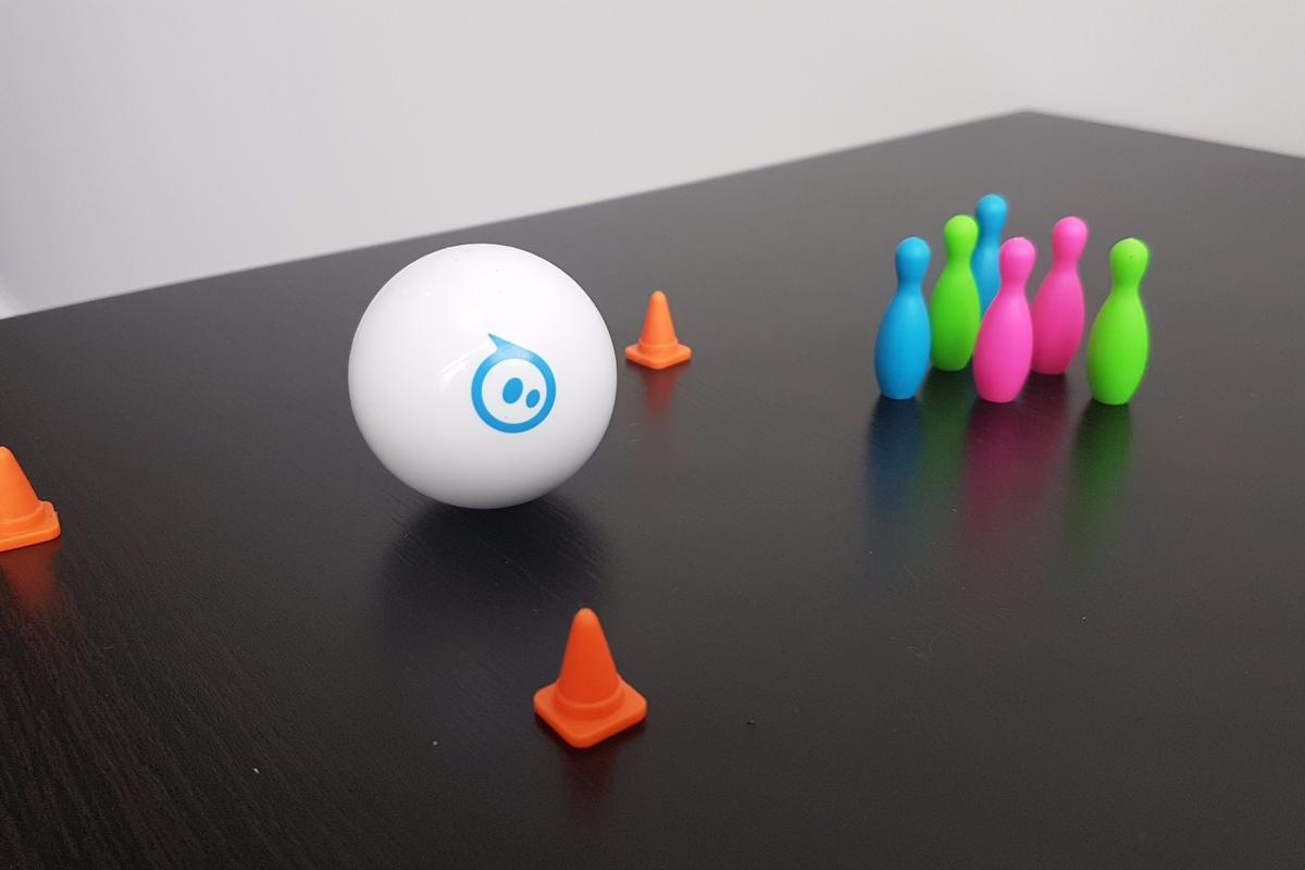 The Sphero Mini comes with a set of traffic cones and bowling pins, to navigate the ball between