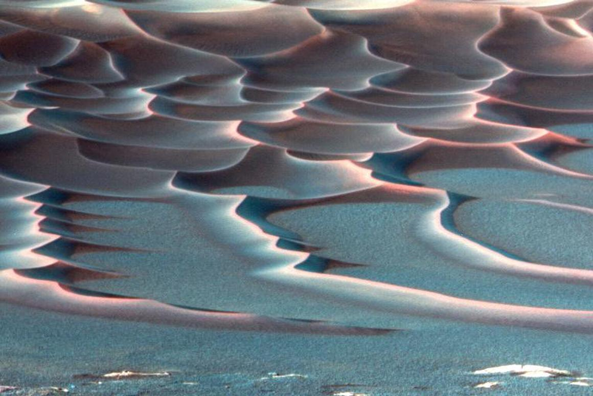 Researchers now believe they know what's responsible for strange wiggly lines formingdown the surface of dunes on Mars, like these found at the bottom of Endurance Crater captured byNASA's Mars Exploration Rover Opportunity