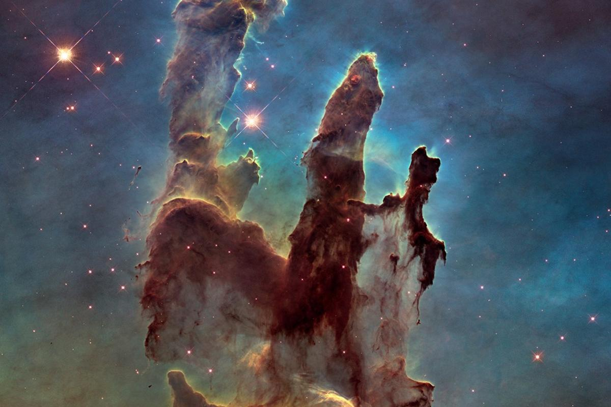 The so-called Pillars of Creation, snapped here by Hubble, is stewing with life-giving organic molecules like those that were recently created under space conditions in the lab