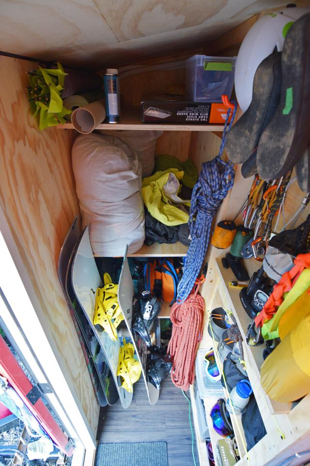 The externally-accessed gear room contains camping, kayaking, and related outdoors equipment