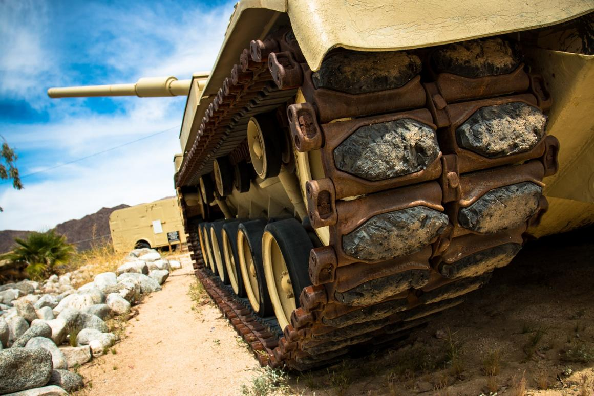 On these tracks with rubber shoes with only 18 inches of ground clearance, the M60 Patton Tank was capable of avertical49 inch obstacle climb and fording waters as deep as 48 inches.