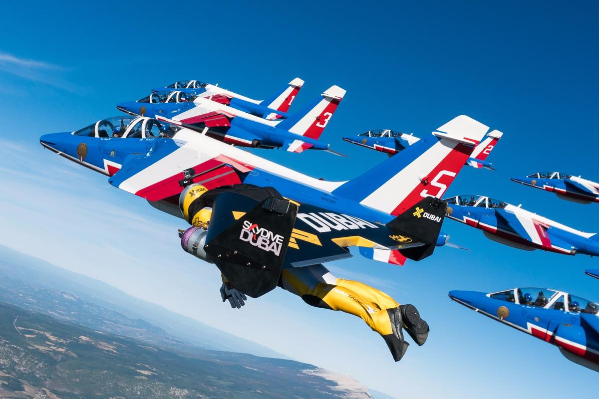 Jetman in close formation with the the Patrouille de France Alphajets