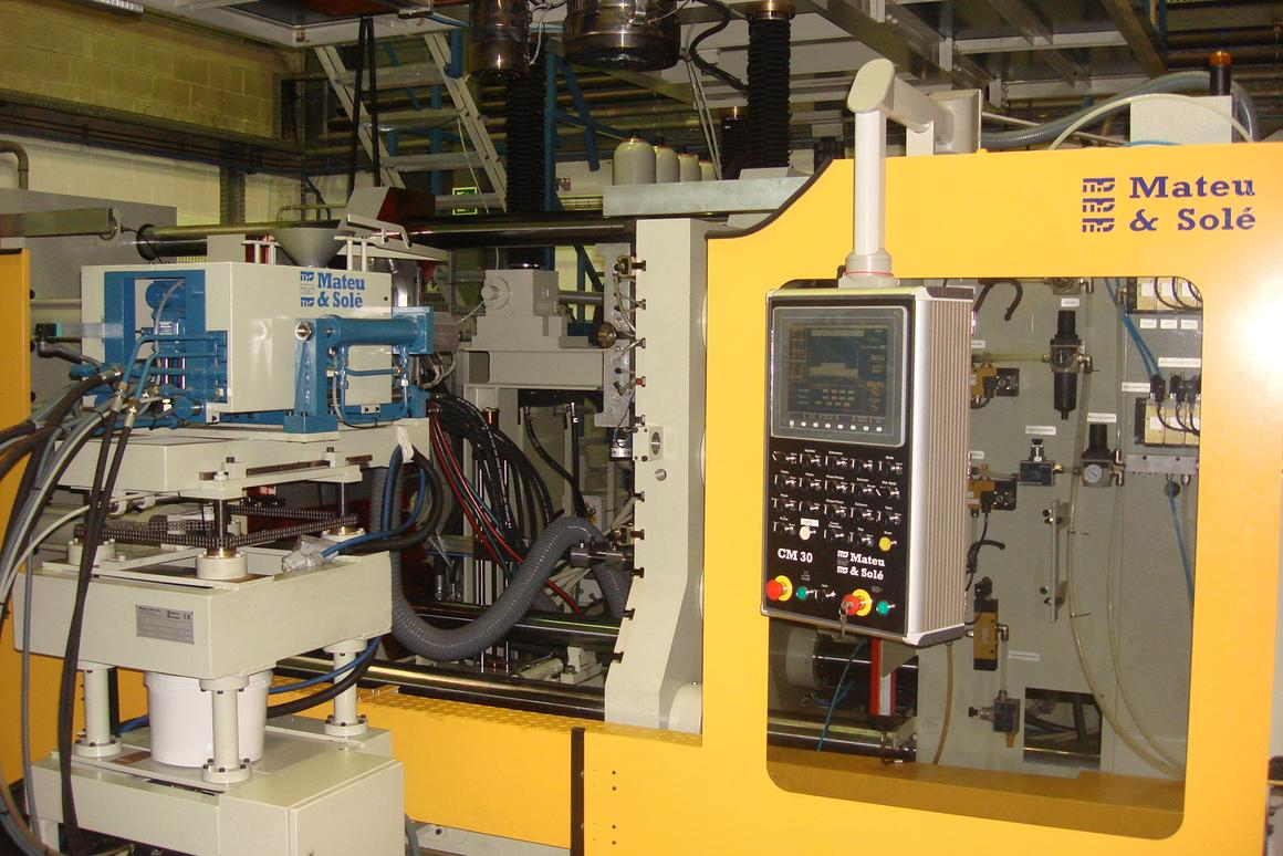 EBIT is based around an extrusion blow-molding platform, with an added injection-molding unit