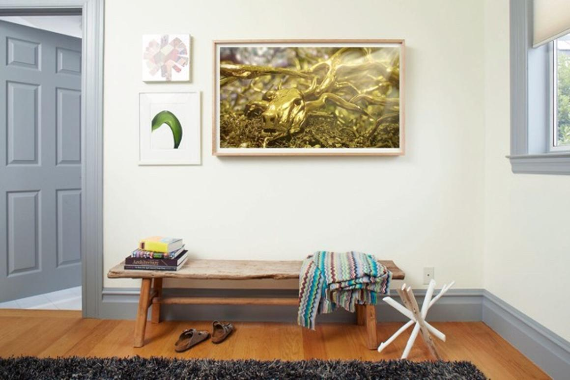 Frame allows users to change up the artwork on their wall, without buying new framed prints