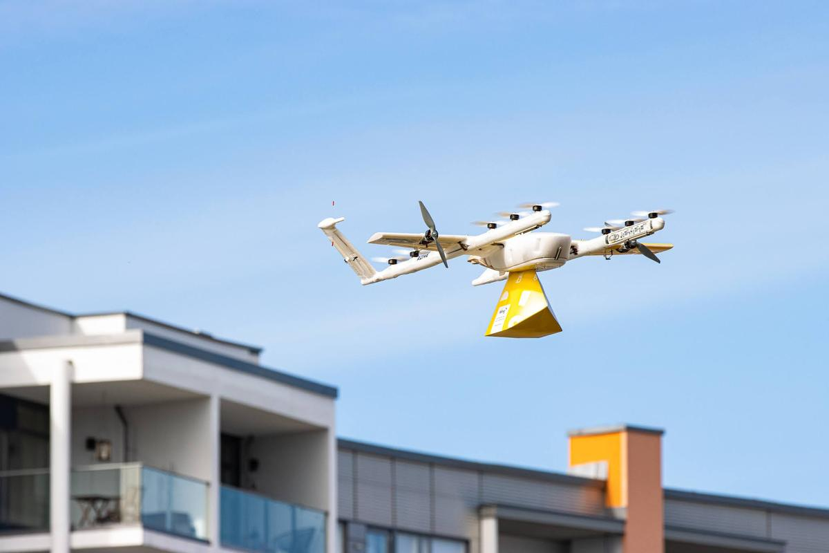 Wing's drone uses 12 small vertical lift props and two cruise props to carry packages up to 1.5 kg at highway speeds