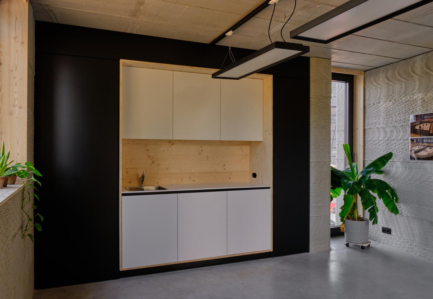 The 3D-printed house includes a simple kitchenette