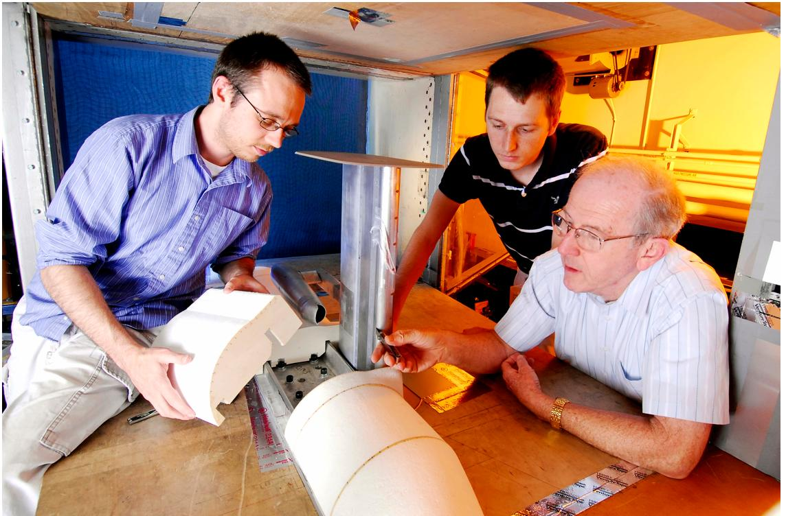 GTRI researchers (from left) Graham Blaylock, Nicholas Moore and Robert Englar assemble a test aircraft's fuselage onto the blown wing assembly, while also measuring the height of the blowing jet exit slot. (Photo: Gary Meek)