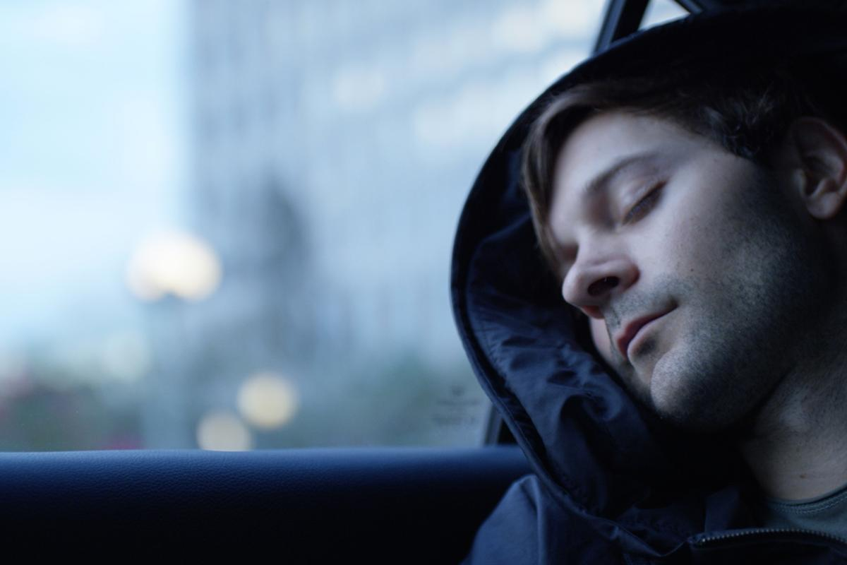 The pillow is formed by an ergonomically designed inflatable unit housed in the hood of the hoodie