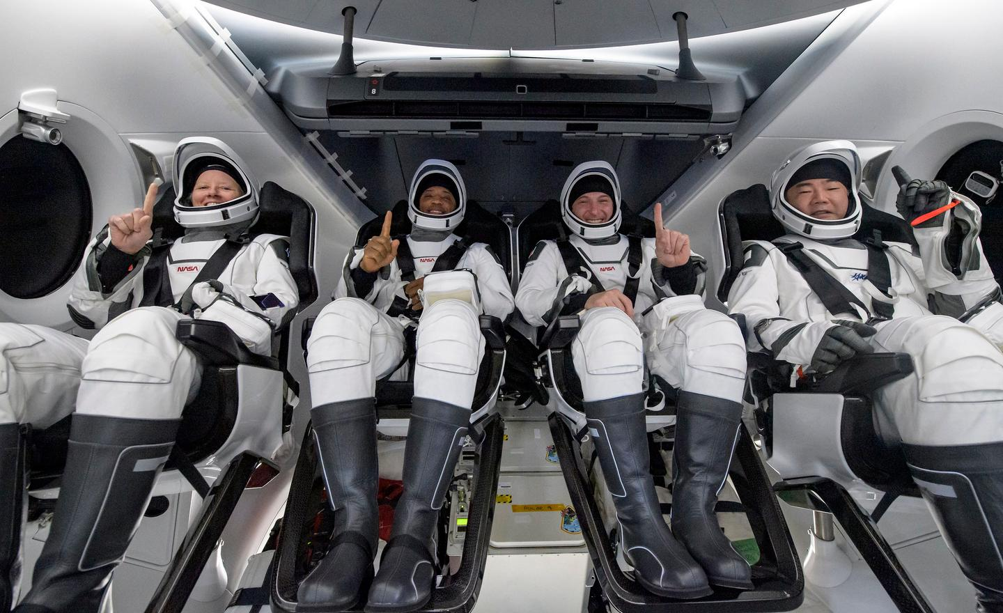 Astronauts Michael Hopkins, Victor Glover, Shannon Walker and Soichi Noguchi shortly after splashing down in SpaceX's Crew Dragon capsule