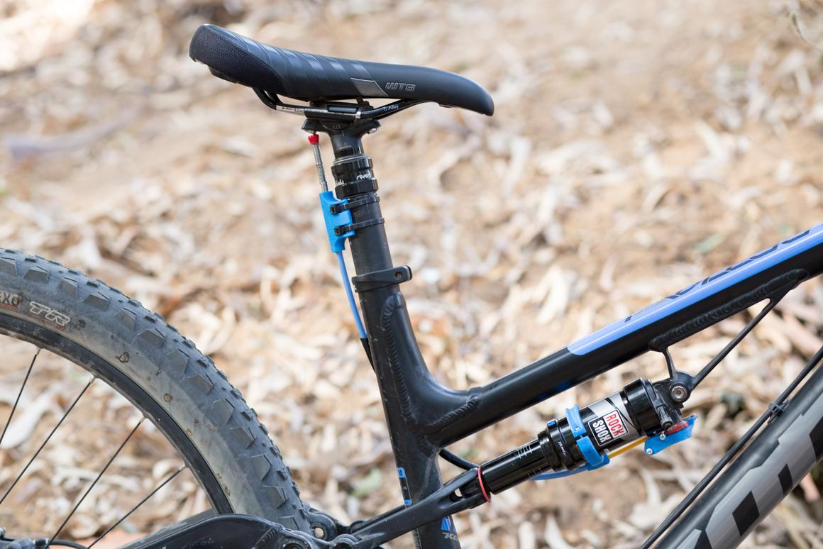 The Killswitch runs between the dropper seatpost and the rear shock's lockout lever