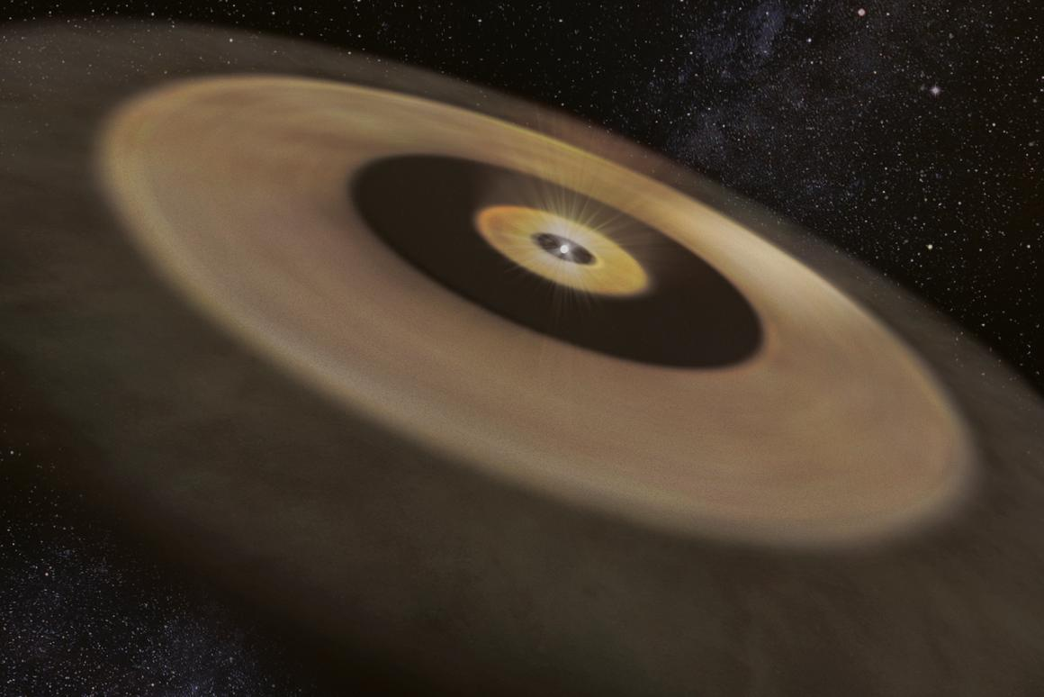 An artist's impression of the two dust disks surrounding the nearby young star DMTau, which could give birth to aplanetary system like our own