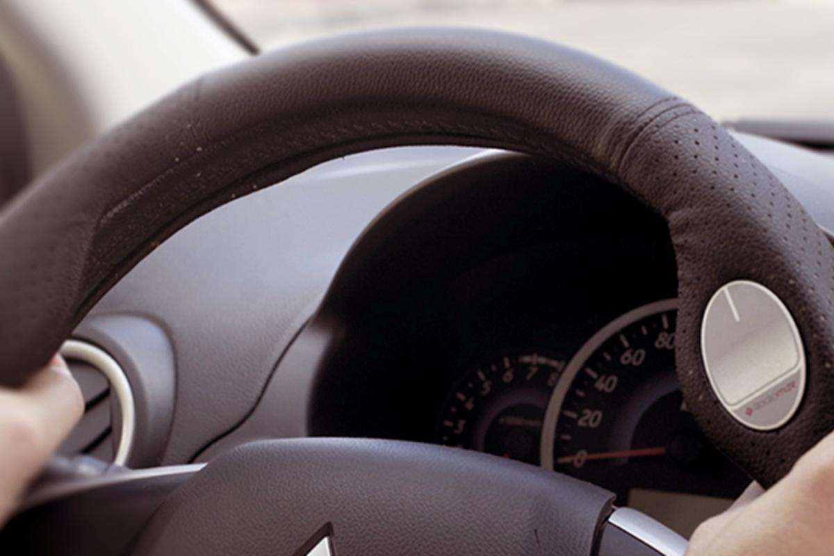 The Radiomize steering wheel cover features a touchpad for wireless control of the driver's smartphone