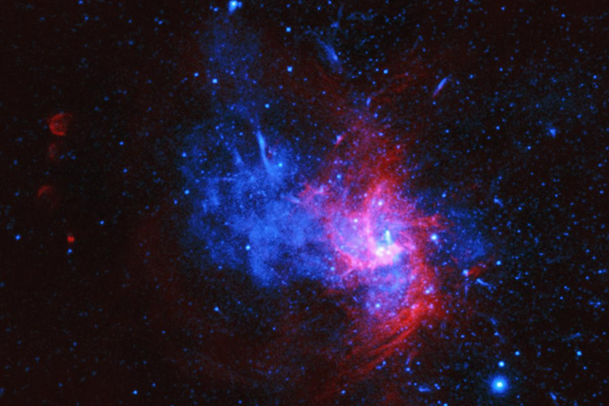 The center of the Milky Way is home to a massive compact object known as Sagittarius A* (bright spot to the right of center of the image)