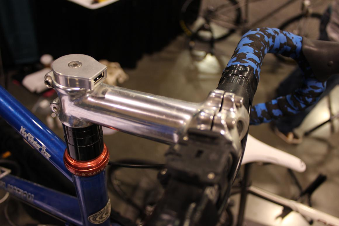 The Sinewave Reactor's USB port replaces the bike's stem cap