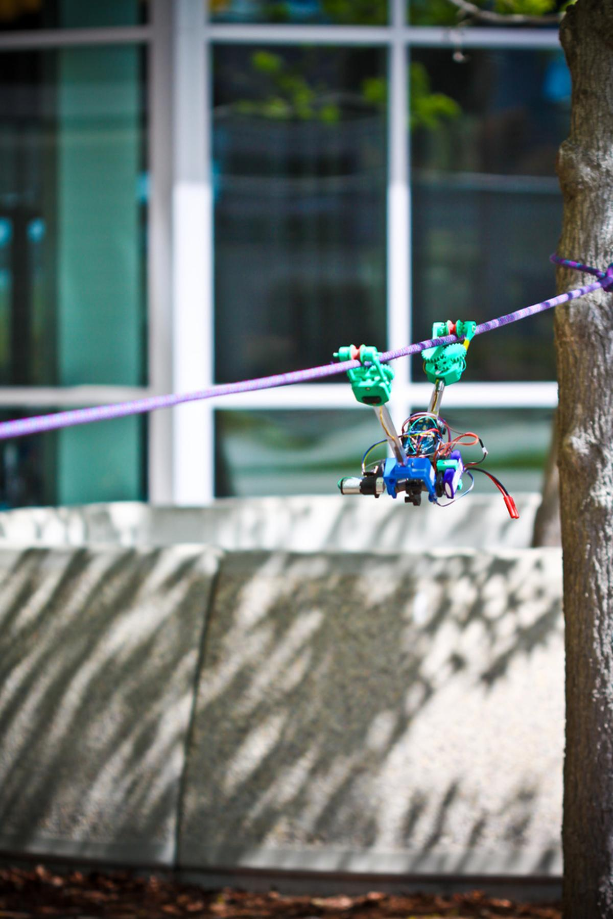 """The SkySweeper robot that inches along a cable using a motorized pivoting """"elbow"""""""