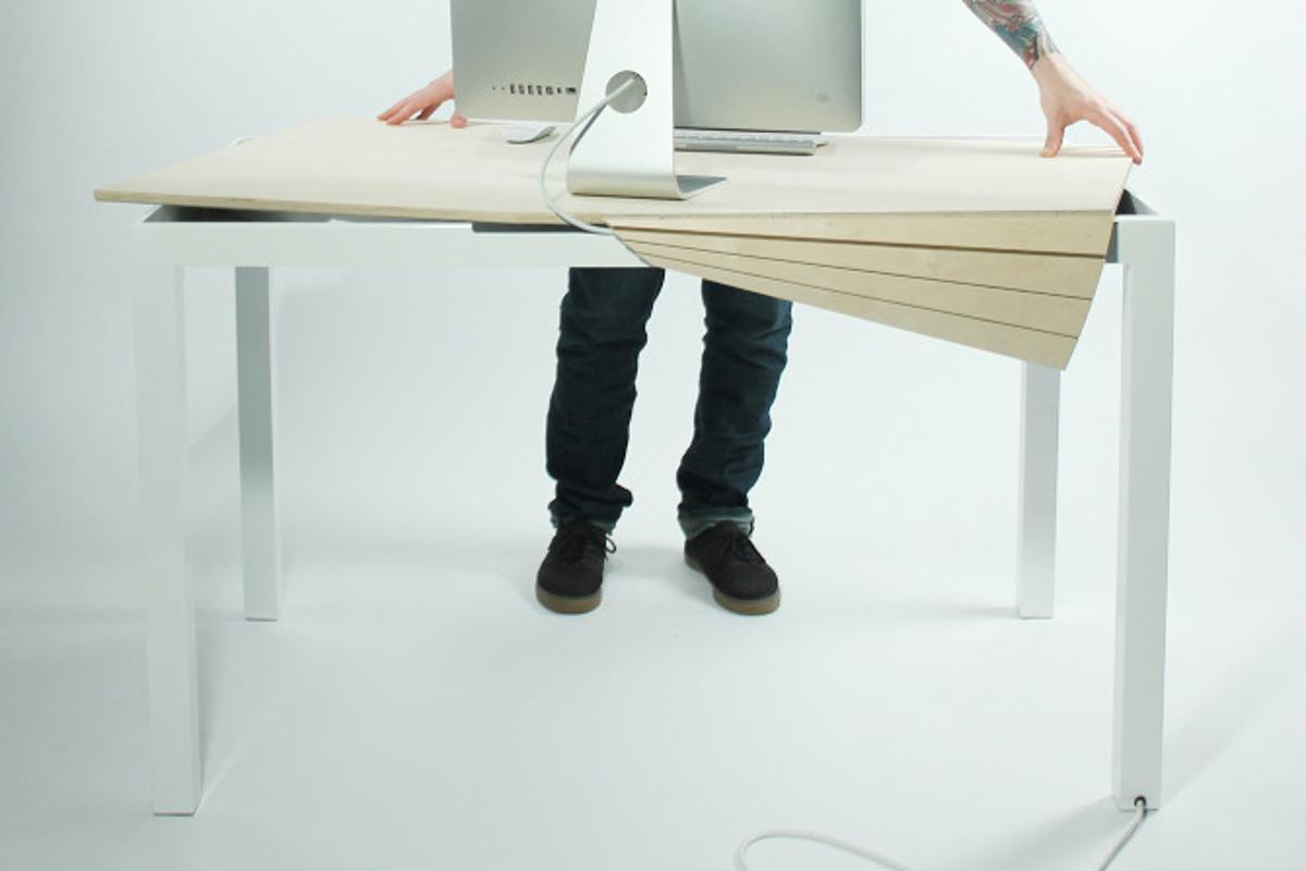 Tambour Table can be manipulated to reveal its hidden void