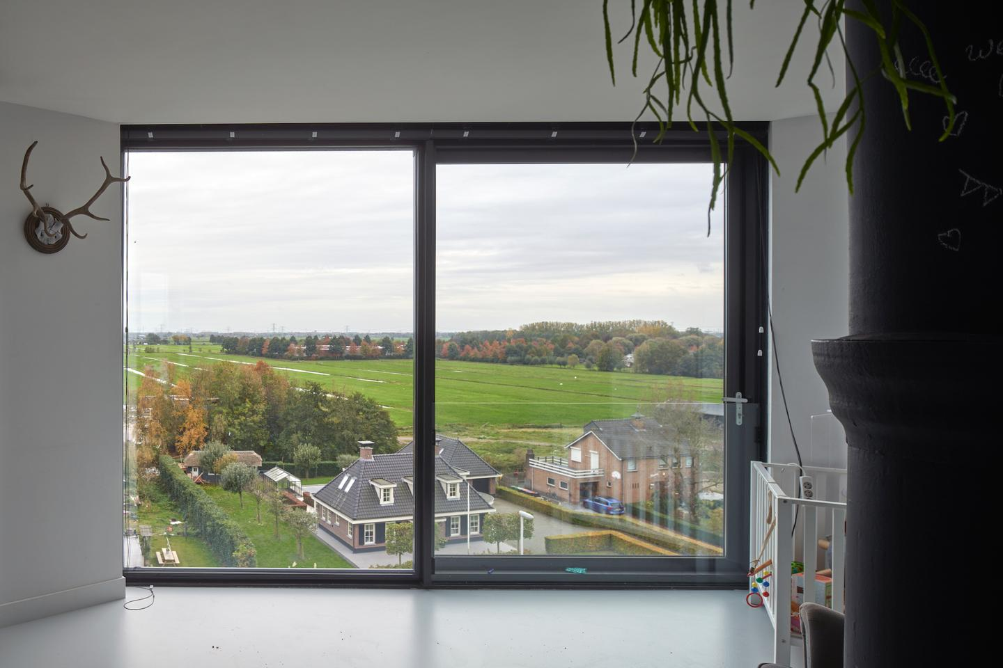 Transformation Watertower Nieuw Lekkerland features generous glazing to frame views of the surrounding countryside