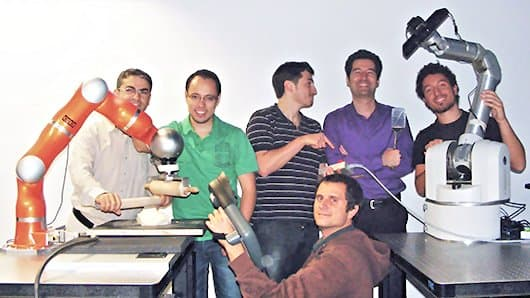 Professor Sylvain Calinon and his robotics group at the Italian Institute of Technology (Photo: IIT)