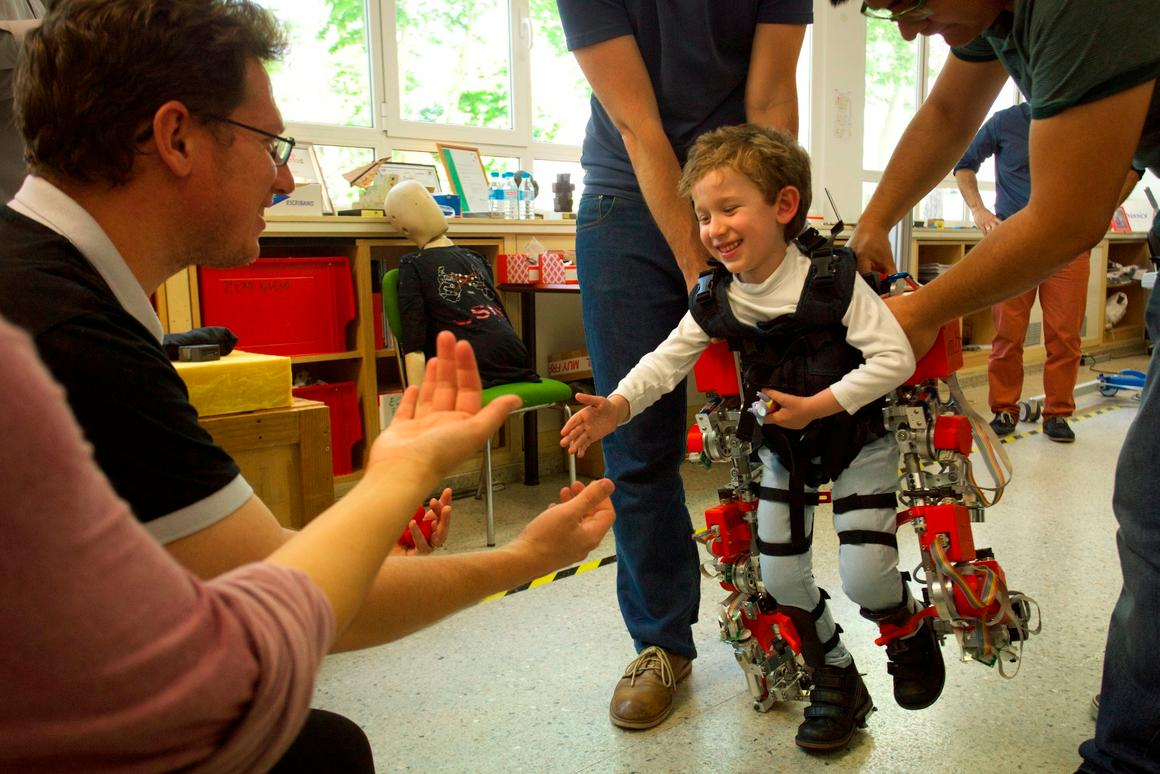 A young user tries out the exoskeleton