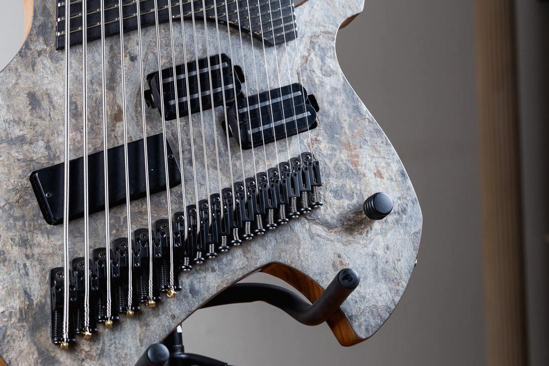 The Dject 2018: 18 strings, three pickups and a face of stone