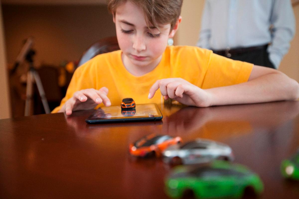The Pocket Racing car will jump and jiggle depending on what happens on screen