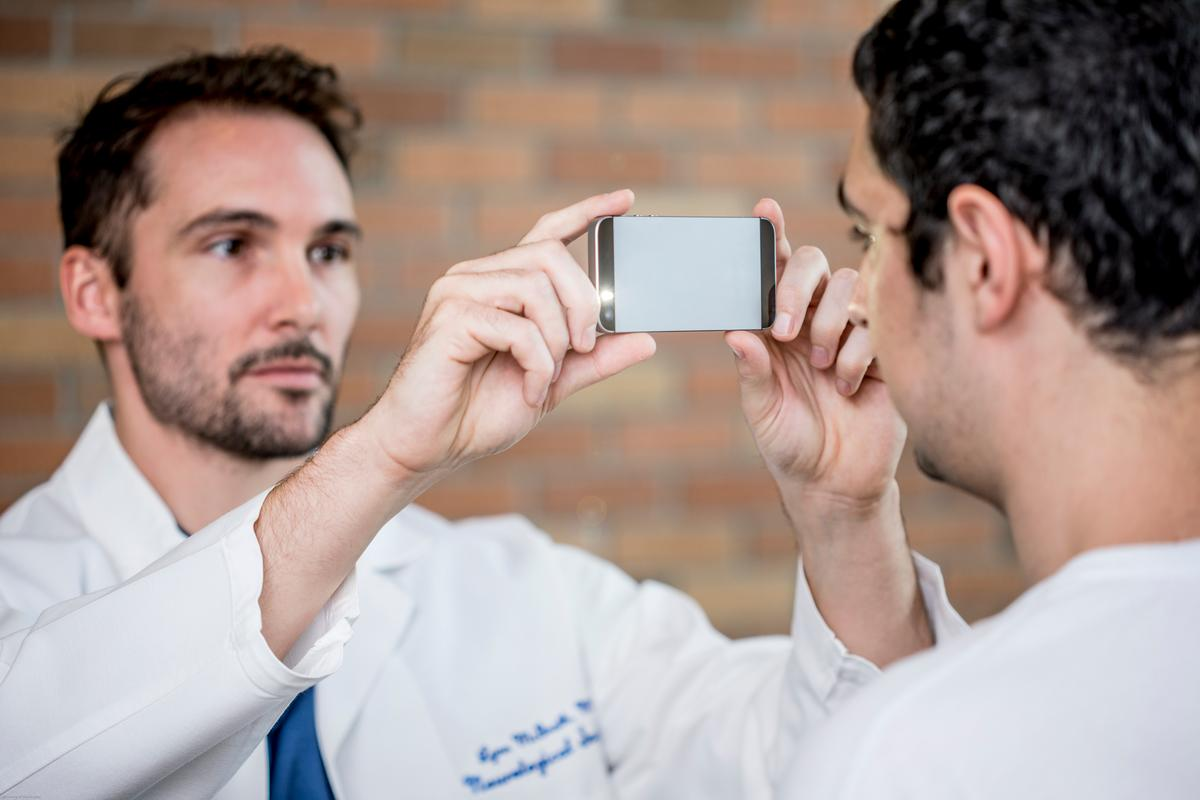 The PupilScreen app uses the phone's flash to stimulate the eye and the camera than captures a three-second video, looking for signs of concussion