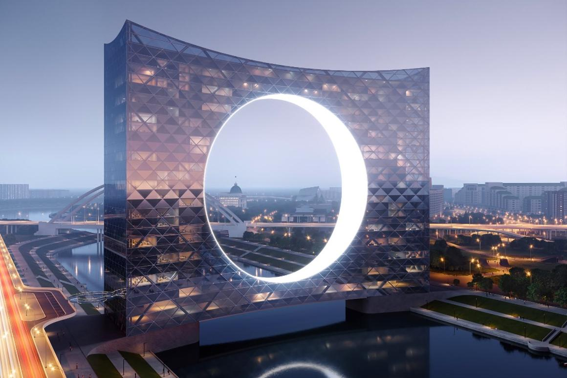 """The Tower of the Sun """"celebrates near net-zero energy requirements by using the power of water stream in the river underneath"""""""