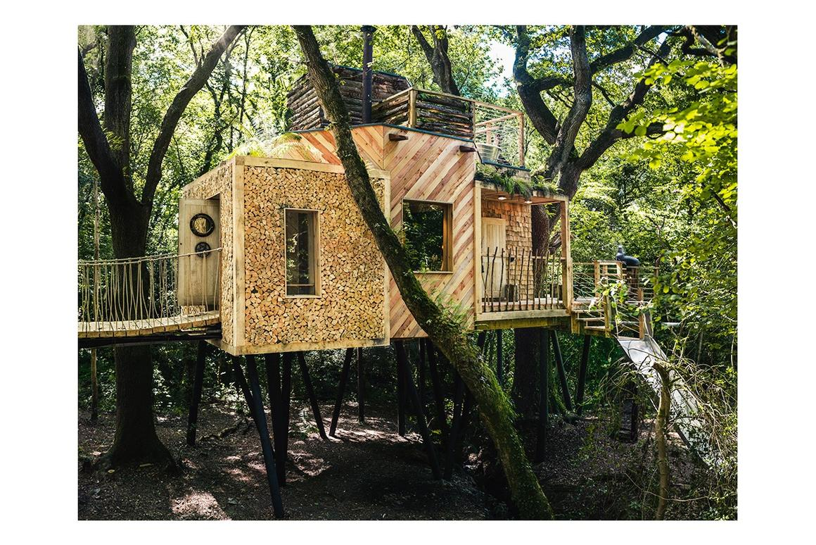 The slide can be seen to the right, there's a hot tub on the roof and access to theWoodsman's Treehouse is gained via an oak door with submarine locking system