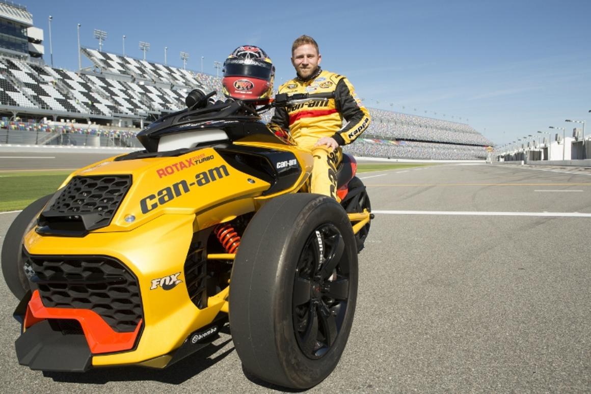 NASCAR Sprint Cup Series driver Jeffrey Earnhardt sits on the Can-Am Spyder F3 Turbo Concept Vehicle