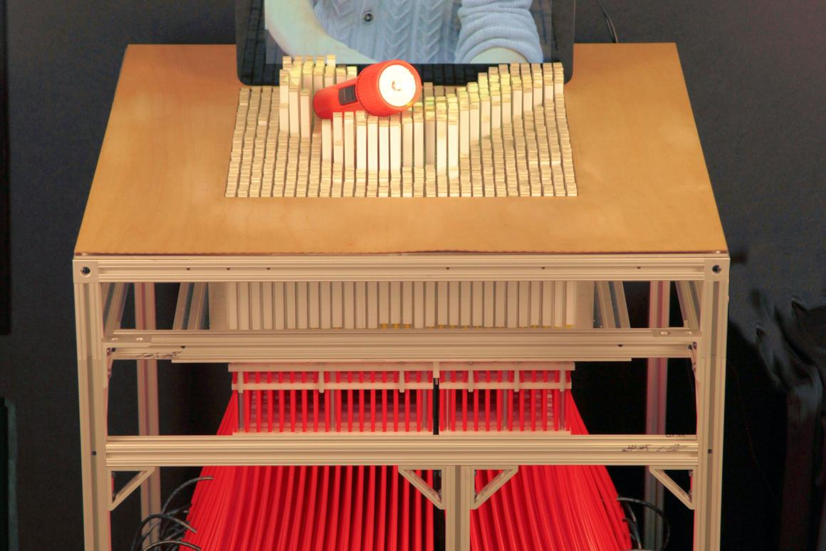 The inFORM display being operated by a remote user via video display (Photo: MIT)