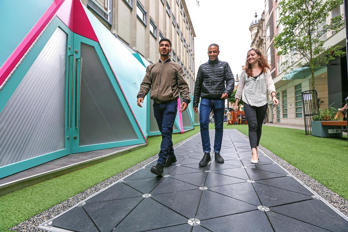 Bird Street shoppers generating electricity just by walking down the Pavegen path installed in Bird Street, London