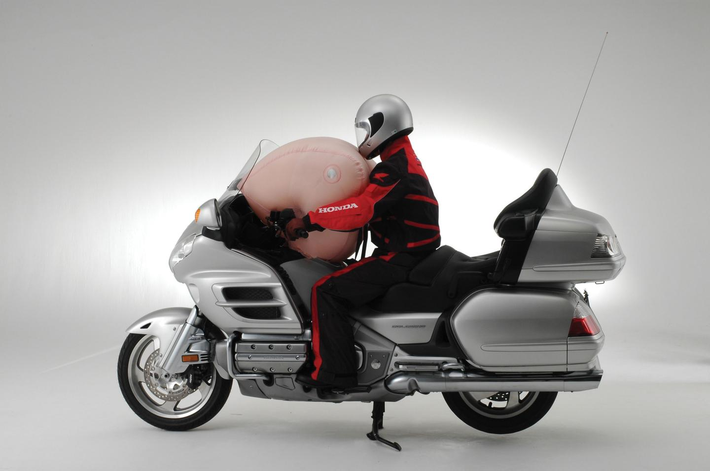 Honda's airbag-equipped Goldwing - deploying the airbag at the bike end.