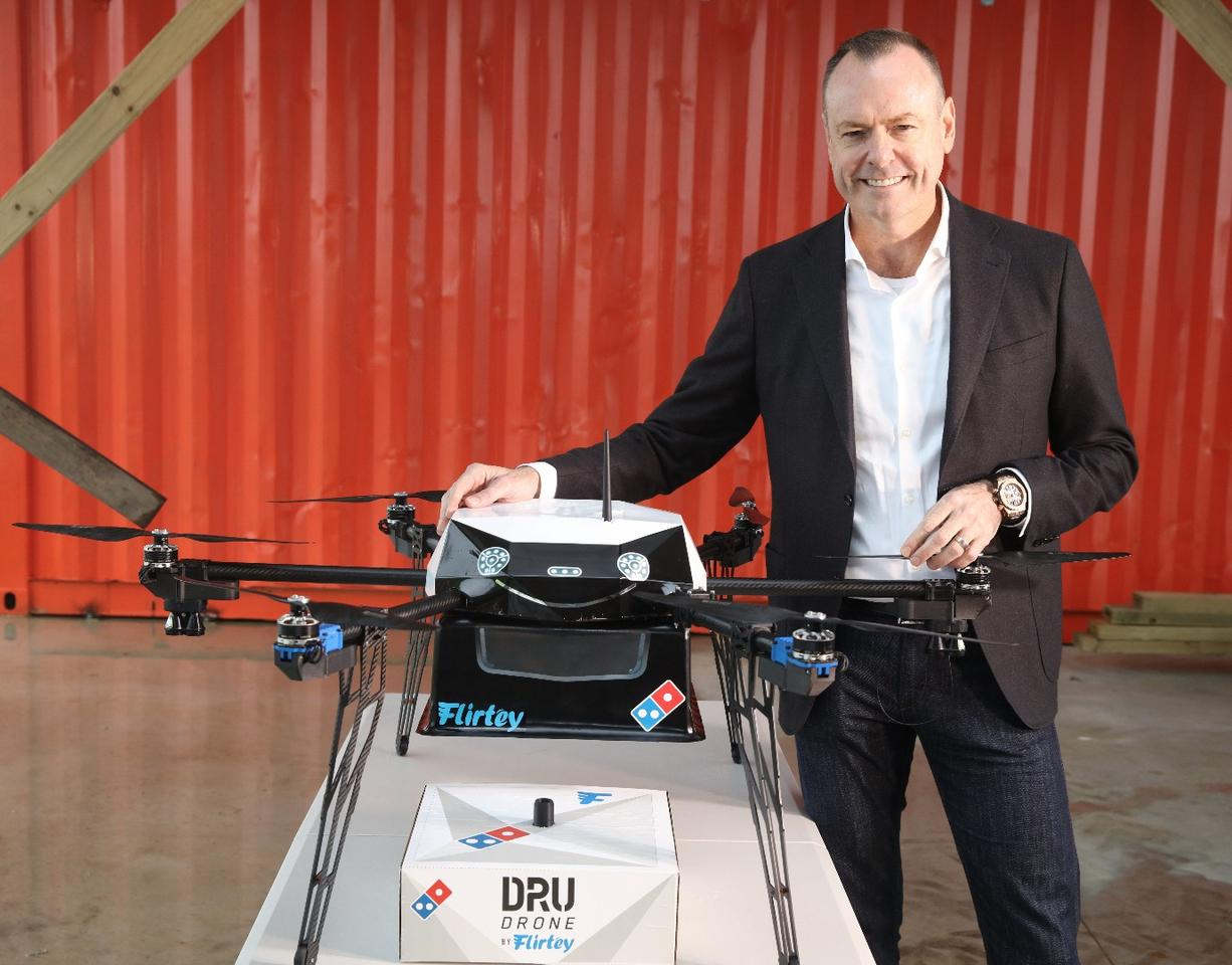 Flirtey's pizza delivery drone with Domino's CEO Don Meij