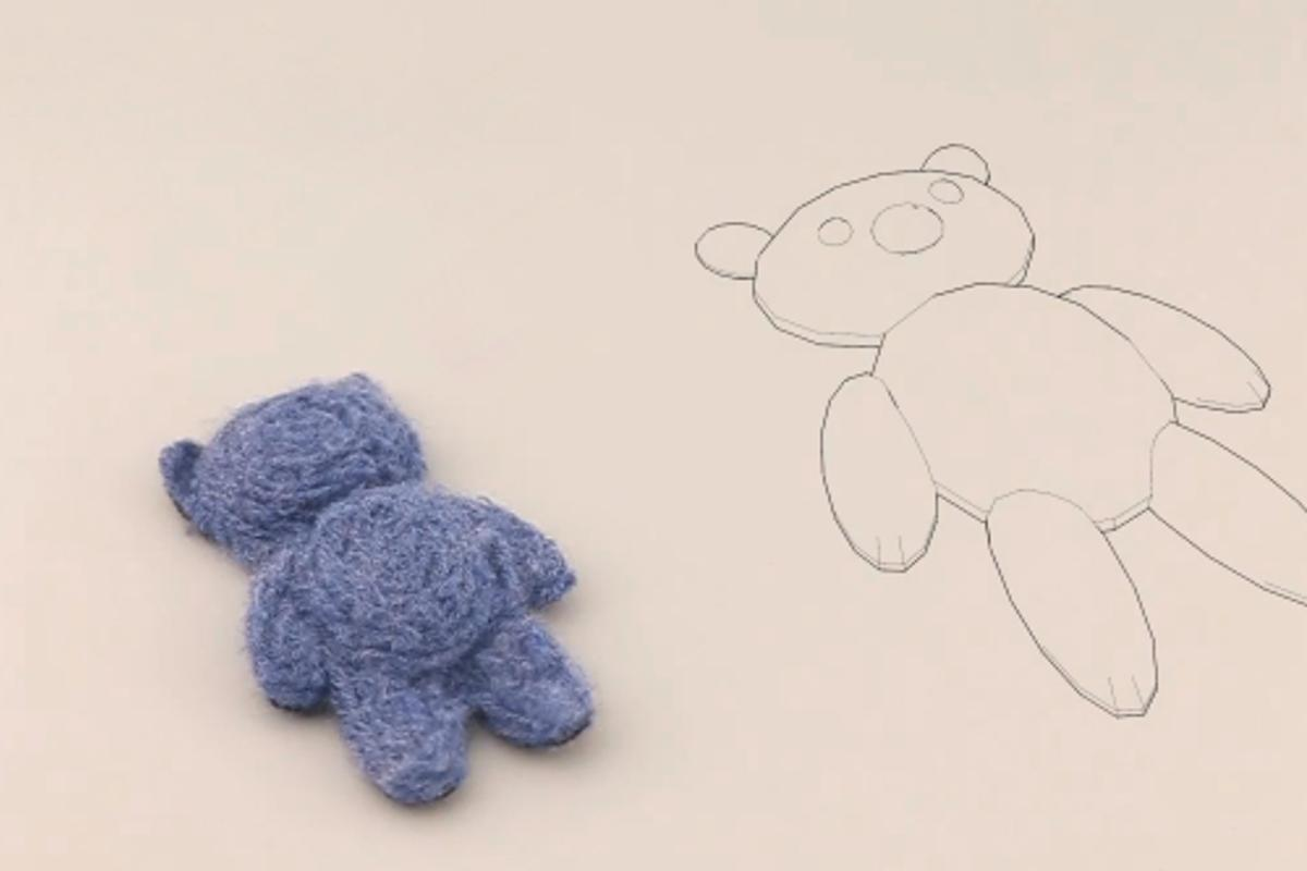 One of the finished felt teddy bears, alongside its digital model